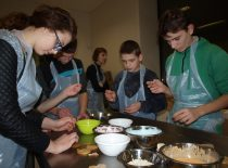 Members of the faculty's student union bake cookies with hearing impaired children on the Advent eve, 2014.