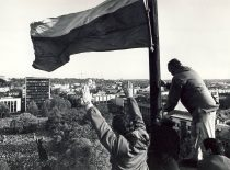 A. Patackas is raising the national flag on the tower of the War Museum, 9 October 1989. (From the archive of A. Patackas)