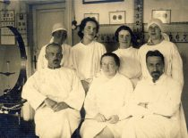 With doctors at the war hospital.