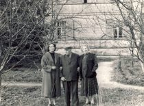 With wife and daughter by their house, 1957.